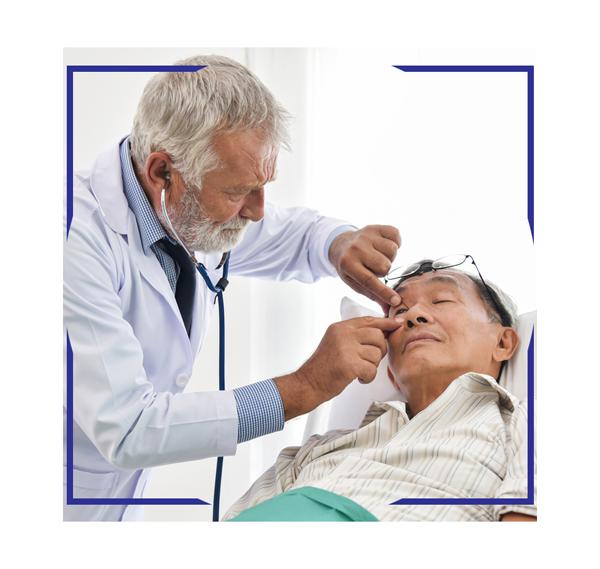eye doctor performing exam on patient, western MA eye doctor, western MA eye surgery center